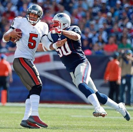 Rob Ninkovich (right) put pressure on quarterback Josh Freeman in the third quarter.