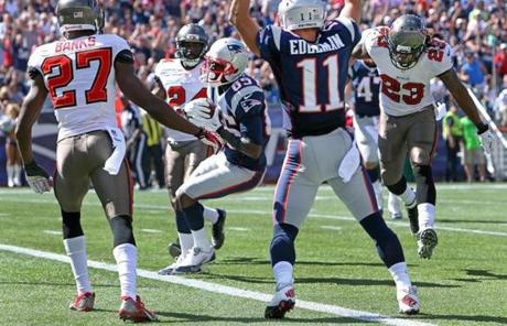 Julian Edelman made the call as Kenbrell Thompkins crossed the goal line with a 16-yard touchdown pass from Brady.