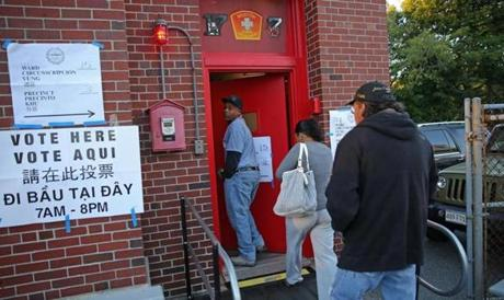 The first voters at the Boston Firehouse on Parish Street came in from the chilly morning.