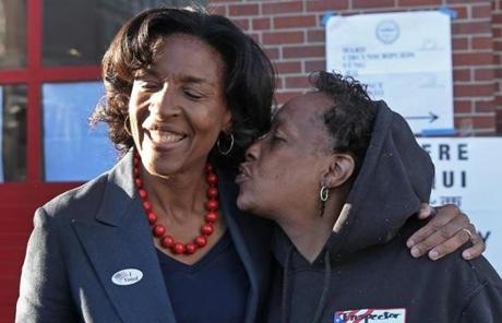 Charlotte Golar Richie got a kiss from Jerri Francis after Richie voted at the Boston Firehouse on Parish Street.