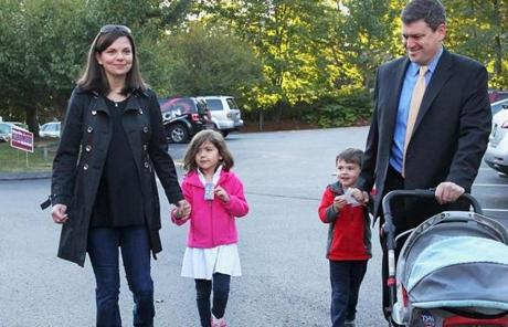 Mayoral candidate John Connolly, accompanied by his wife, Meg, Clare, 5, and Teddy, 4, arrived to vote at St. George Orthodox Church in West Roxbury.