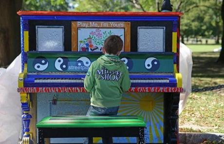 "Alan Spruhan, from Ireland, played piano on Boston Common as part of the ""Play Me I'm Yours"" street piano festival."