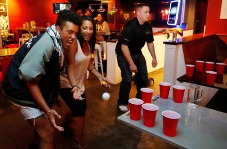 "Nanshon Rosenfeld of Boston and Asia Schultz of Lexington, both 21, played ""bar pong"" at Tasty Burger. It stays open for hungry students and clubgoers until 4 a.m."