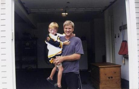 "Bobby Orr holding Kevin Keyes  Jr., 6, a hockey fan who is legally blind. ""He is the nicest, most generous, most sincere person my children will ever meet,"" Kevin's father said."