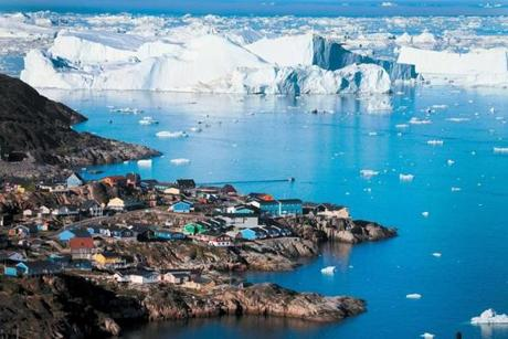 The village of Ilulissat is near icebergs that broke off from the Jakobshavn Glacier in July 2013 in Greenland. Sea levels around the world are rising.