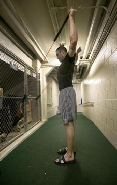 Chicago, Ill.-Globe Staff photo by Stan Grossfeld- September 24, 2011-- Pirate pitcher Kyle Farnsworth limbers up after pitching at Wrigley Field