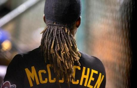 Piratess center fielder and MVP candidate Andrew McCutchen in the dugout at Wrigley Field.