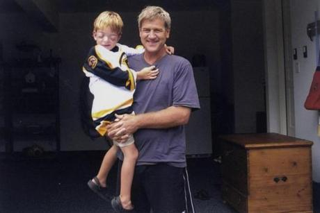 Bobby Orr spends some time with a new friend, 6-year-old Kevin Keyes Jr., who stopped by for lunch, as well as fun and games, at the legend's home.