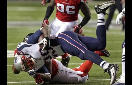 New England wide receiver Kenbrell Thompkins  was hauled down after a pass reception in the second quarter.