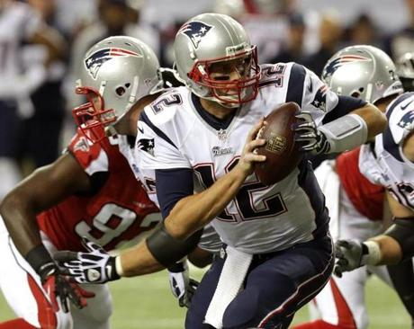 Brady  looked to hand off late in the second quarter.