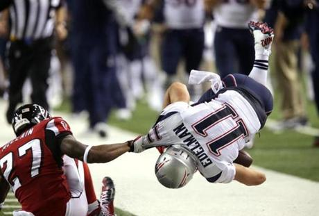Edelman was hauled down out of bounds after a long catch and run in the fourth quarter.