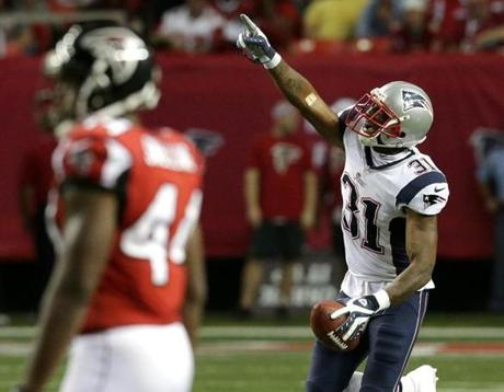 New England Patriots cornerback Aqib Talib celebrated an interception in the fourth quarter.
