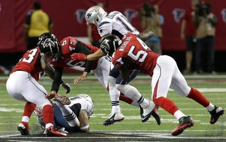 New England tight end Michael Hoomanawanui  pounces on an onside kick.