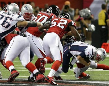 New England Patriots quarterback Tom Brady  dove forward for a first down.