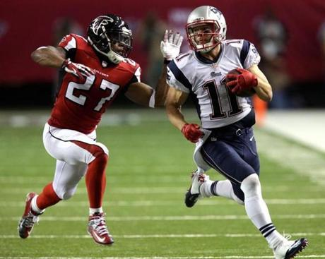 Edelman has a step on Atlanta Falcons cornerback Robert McClain as he took it 44 yards down the sideline on a short pass reception.