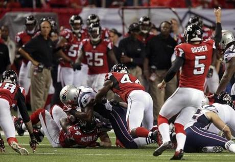 Falcons outside linebacker Stephen Nicholas recovered an onside kick by Atlanta.