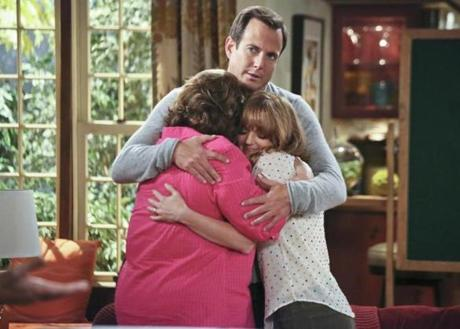"Will Arnett, Margo Martindale (left) and Jayma Mays in ""The Millers."""