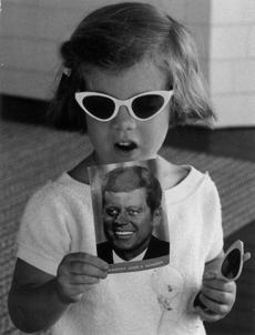 Caroline Kennedy with a postcard of her dad, 1962.