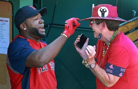 Designated hitter David Ortiz admired Lynne Smith of Wellesley's hat. Fans were allowed into the park for free.