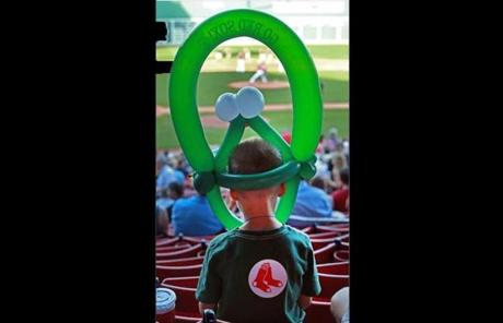 A young fan wore a balloon animal hat.