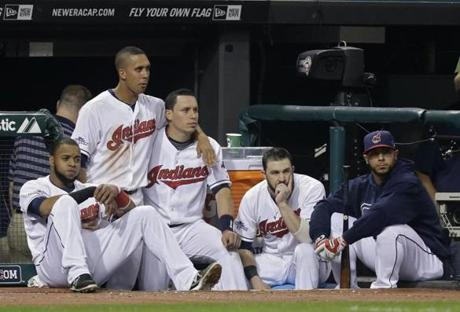 Some Indians players watched as the Rays celebrated their victory in the American League wild-card game.