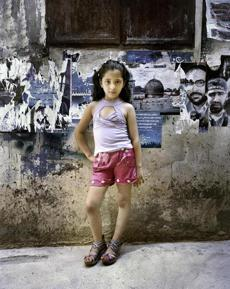 "Rania Matar's photograph ""Dania, 9, Bourj El Barejneh Refugee Camp, Beirut, Lebanon"" at Carroll and Sons."