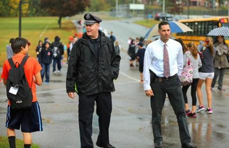 Canton school resource officers Ted Lehan and Chuck Rae monitor class dismissal at Galvin Middle School last fall. Canton has implemented a new lockdown training drill offering more options.
