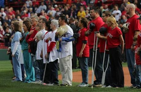 First responders and family members of those injured or killed in the Boston Marathon bombings were recognized before the game.