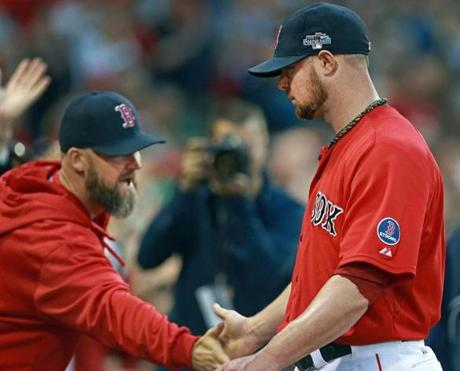 Starting pitcher Jon Lester (right) got a hand from teammate David Ross (left) as he left the game in the eighth.