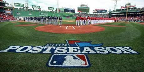 The teams lined up after the pregame player introductions. The Red Sox hosted the Tampa Bay Rays in Game 1 of their ALDS playoffs at Fenway Park.