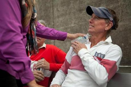 Bill Schleyer iced his shoulder after bruising it during a rugby match against other Harvard alumni.
