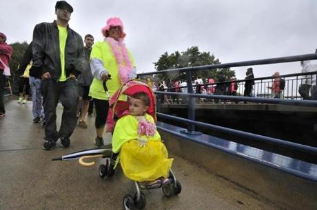 Lisa Corcoran (center) donned a furry pink hat to join her son Justin Diflaminiess and 3-year-old granddaughter Alaina Diflaminiess.