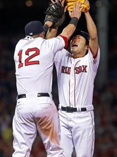Mike Napoli (left) and Koji Uehara are sky high after the Red Sox took a 2-0 lead over the Rays in the ALDS.