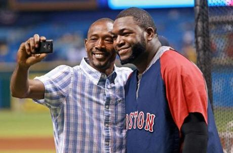 David Ortiz posed for a photo with a friend during batting practice.