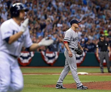 The Rays David DeJesus clapped as he and Red Sox starter Jake Peavy watched his sixth-inning single drop in safely to drive in Yunel Escobar and give Tampa Bay a 1-0 lead.