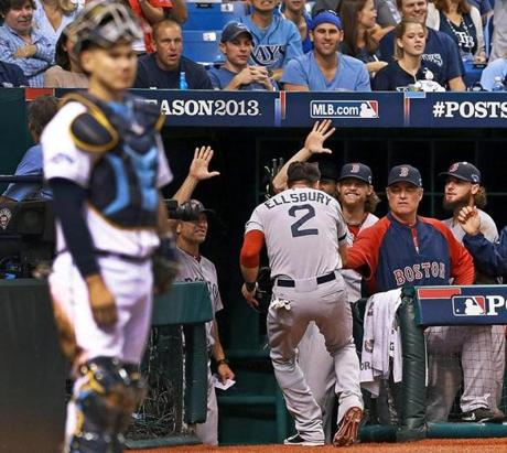 Jacoby Ellsbury was welcomed to the dugout after he scored in the seventh inning.
