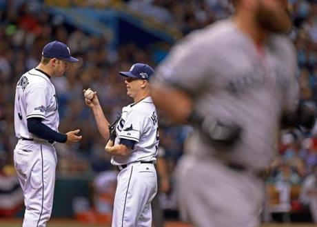 Evan Longoria talked to Rays starter Jeremy Hellickson after he walked the Mike Napoli (right), his second free pass in a row in the second inning.