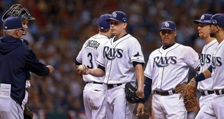 Rays manager Joe Maddon pulled starting pitcher Jeremy Hellickson with the bases loaded and no one out in the second inning.