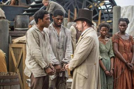 "Ejiofor (left) and Paul Giamatti (far right) in ""12 Years a Slave."""