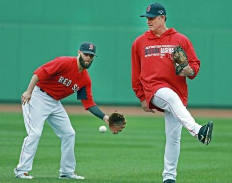 Farrell (right) stepped out of the way of a ball hit in his direction.