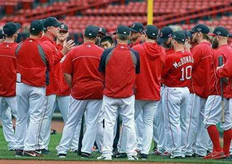 Red Sox manager John Farrell (left) talked with his team before the start of batting practice.