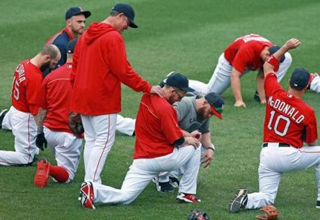Farrell gave Stephen Drew a neck massage as the players stretched.
