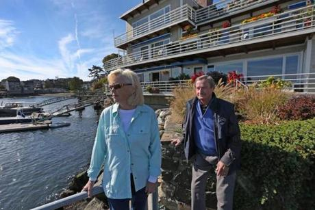 """The premium is not reflective of the risk,"" said Joyce Raymond, standing with resident Don Nowland of Harborside."