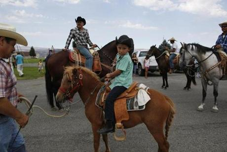 Juan Erazo held the lead line of his son Azel's pony, Carinoso, as they rode during the Mattawa Community Days parade.