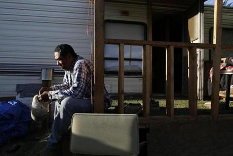 Javier Preciado, 55, of Nayarit, Mexico, sat on the steps of the trailer he shares with two other agricultural workers in the Riverview Trailer Park in Mattawa.