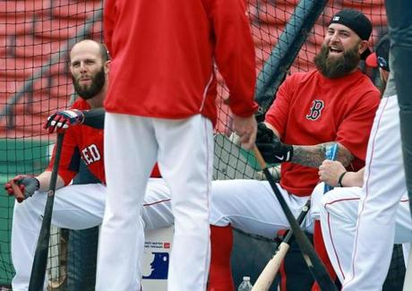 Dustin Pedroia (left) and Mike Napoli relaxed inside the batting cage as they waited for the workout to begin.