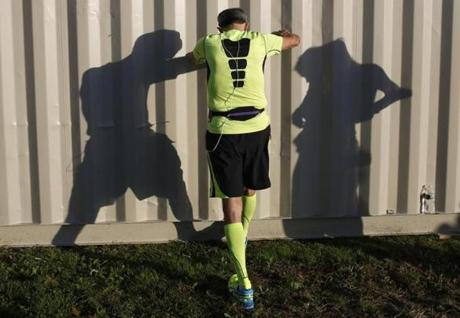 Jack Cumming of Sudbury stretches before the start of the BAA half marathon in Boston, Massachusetts October 13, 2013. (Jessica Rinaldi For The Boston Globe)