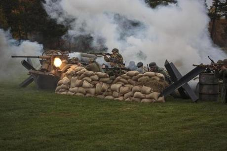 In Stow, the Collings Foundation presented its World War II reenactments featuring American and German troops, planes, tanks, and guns in mock battle as history lessons.