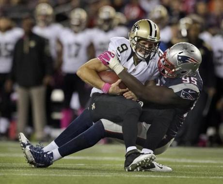 Chandler Jones sacked Saints quarterback Drew Brees.