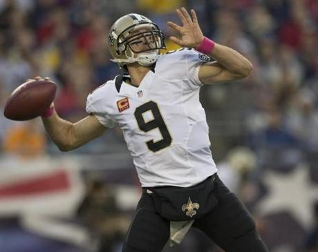 Brees threw a pass against the Patriots in second-quarter action.